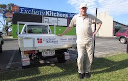 Exclusiv Kitchens Bayside Owner Standing in front of their Kitchen Showroom in Capalaba, QLD